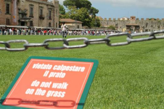 An Indian lady strutting though the gardens of Pisa. Skipped the chains and ignored the four signs!!
